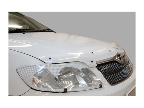 Защита фар Nissan Navara 2005-2010 СА Пластик - фото 20944